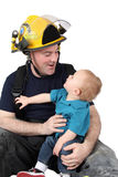 Fireman dad. Son of a fireman looking up at him Royalty Free Stock Images