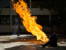 The fireman demonstrates how to suppress fire. From gas tanks royalty free stock photos