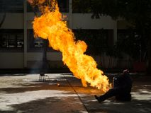 Fireman demonstrates how to suppress fire from gas tanks. The fireman demonstrates how to suppress fire from gas tanks royalty free stock photography