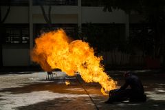 Fireman demonstrates how to suppress fire from gas tanks. The fireman demonstrates how to suppress fire from gas tanks royalty free stock photos
