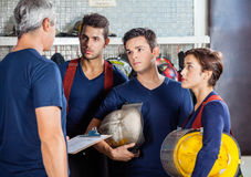 Fireman Discussing With Team Royalty Free Stock Photos