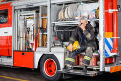 Fireman Drinking Coffee While Sitting In Truck Royalty Free Stock Photo