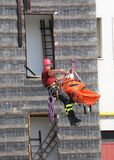 Fireman during an exercise carries the stretcher with the climbi Royalty Free Stock Photo