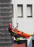 Fireman during an exercise carries the stretcher with the dummy Royalty Free Stock Images