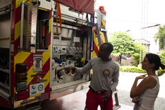 Fireman explaining the different tools in a fire truck Royalty Free Stock Image