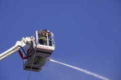 Fireman on an extended boom Royalty Free Stock Photography