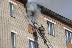Fireman extinguish a fire  in apartment Royalty Free Stock Image