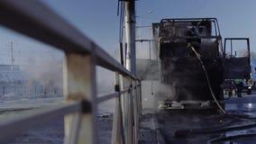 Fireman extinguish a truck stock video