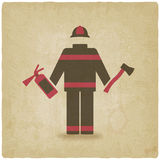 Fireman with extinguisher and axe old background. Vector illustration - eps 10 Stock Image