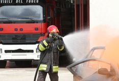 Fireman extinguishes the fire after car accident 1 Royalty Free Stock Images