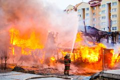 Fireman extinguishes a fire Stock Images