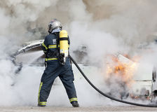 Fireman in fire Stock Image