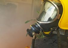 Fireman during a fire. Simulation Royalty Free Stock Photos