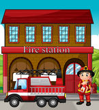 A fireman with a fire truck in a fire station. Illustration of a fireman with a fire truck in a fire station Stock Photo