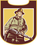 Fireman Firefighter Aiming Fire Hose Shield Retro. Illustration of a fireman fire fighter emergency worker holding fire hose viewed from front set inside shield Royalty Free Stock Images