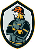 Fireman Firefighter Arms Folded Shield Retro. Illustration of a fireman fire fighter emergency worker arms folded looking to the side set inside shield crest on Stock Image