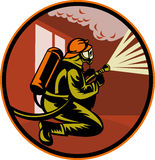 Fireman firefighter fighting fire. Illustration of a Fireman firefighter kneeling with fire hose fighting fire and smoke set inside circle Stock Image