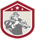 Fireman Firefighter Fire Hose Shield Retro. Illustration of a fireman fire fighter emergency worker with fire hose set inside shield crest shape done in retro Stock Images