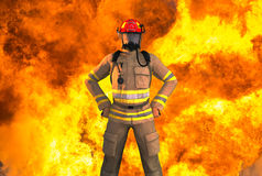 Fireman, Firefighter, First Responder, Fire, Explosion. Illustration of a fireman, hero, or first responder. The firefighter has a fire, fireball, or explosion Stock Images