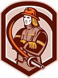 Fireman Firefighter Folding Arms Shield Retro. Illustration of a fireman fire fighter emergency worker folding arms with fire hose set inside shield crest on Royalty Free Stock Photo