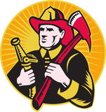 Fireman firefighter holding ax fire hose. Illustration of a fireman firefighter holding ax and fire hose set inside circle done in retro woodcut style Royalty Free Stock Photography