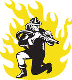 Fireman firefighter kneel aim fire hose. Illustration of a fireman firefighter kneeling aim fire hose with flames in background done in retro woodcut style Royalty Free Stock Image