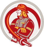 Fireman Firefighter Standing Folding Arms Circle. Illustration of a fireman fire fighter emergency worker standing folding arms with fire hose viewed from the Royalty Free Stock Photography