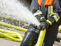 Fireman with a firehose Royalty Free Stock Image