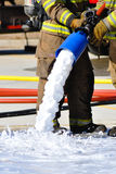 Fireman Foam Nozzle. Live Fire burn photographic image Royalty Free Stock Images