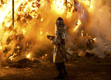 Fireman in front of a big fire. Fireman in front of a big ceremonial bonfire in Yoshida Shrine & x28;Kyoto, Japan& x29 royalty free stock photo