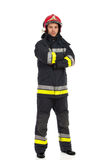 Fireman, full length. Serious firefighter posing with arms crossed. Full length studio shot  on white Stock Photography