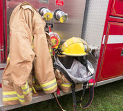 Fireman gear. A fire fighters gear hung on the side of a firetruck Stock Images