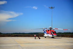 Fireman is guarding for helicopter before start up engine Royalty Free Stock Photography
