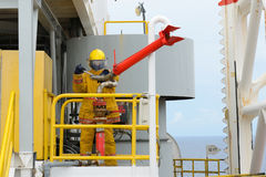 Fireman is guarding for offshore helicopter before start up engi Stock Photography