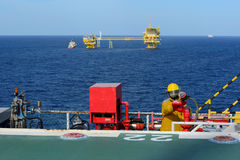 Fireman is guarding for offshore helicopter before start up engi Royalty Free Stock Photo