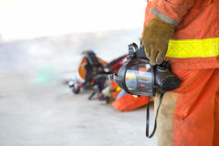 Fireman hand in glove hold oxygen mask Stock Image