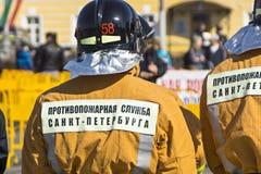 Fireman in helmet Stock Images