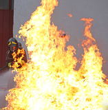 Fireman with high flames very hot Stock Image