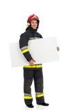 Fireman holding banner under the arm Stock Photos