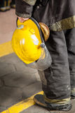 Fireman Holding Helmet At Fire Station Stock Image