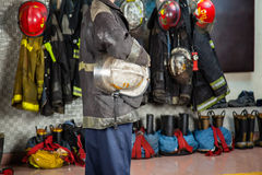 Fireman Holding Helmet At Fire Station Royalty Free Stock Image