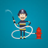 Fireman holds fire hose and smiling Royalty Free Stock Photography