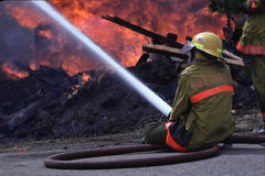 Fireman with hose Royalty Free Stock Photo