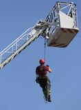 Fireman hung the rope climbing during fire drill stock photography