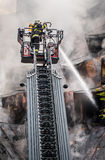 Fireman on ladder Royalty Free Stock Photography