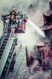Fireman on ladder Stock Photography
