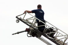 Fireman On Ladder Truck. A fireman on the ladder of a ladder truck Royalty Free Stock Images