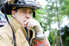 Fireman looks away from camera Royalty Free Stock Image