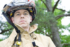 Fireman Looks at Camera Royalty Free Stock Photography