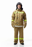 Fireman. Mature fireman in uniform on a white background Royalty Free Stock Photos